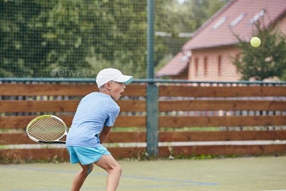 Little boy playing tennis - Stock Photo - Images
