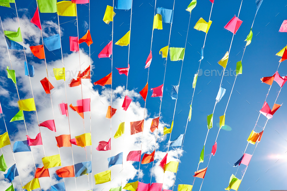 Colorful flags agaist the sunny sky - Stock Photo - Images