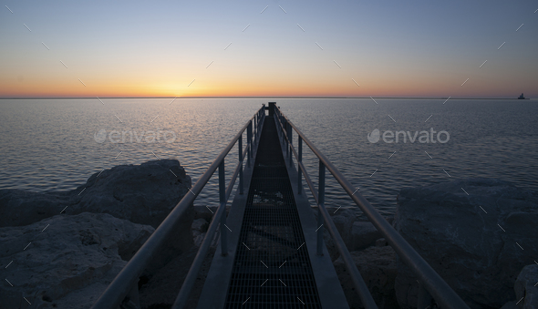Sunrise Comes to the Great Lakes and this Metal Walkway - Stock Photo - Images