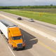 Orange Semi Truck Trailer Rig Hauls Freight on Divided Highway - PhotoDune Item for Sale