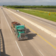 Teal Semi Truck Trailer Rig Hauls Freight on Divided Highway - PhotoDune Item for Sale