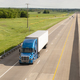 Blue Semi Truck Trailer Rig Hauls Freight on Divided Highway - PhotoDune Item for Sale