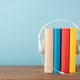 Stack of books with headphones - PhotoDune Item for Sale