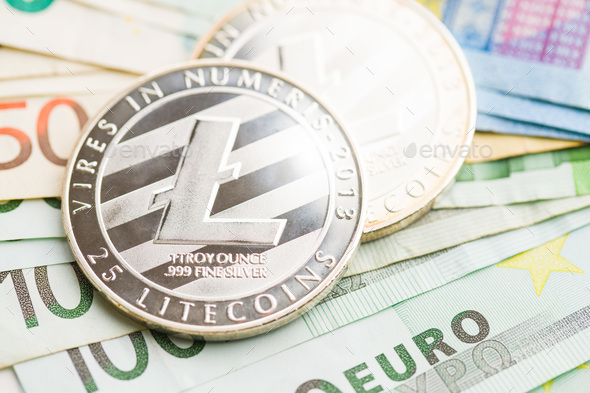 Litecoin and euro banknotes. - Stock Photo - Images