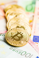 The golden bitcoin and euro currency. - PhotoDune Item for Sale