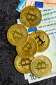 Golden bitcoins and euro banknotes. - PhotoDune Item for Sale