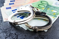Handcuffs and euro money. - PhotoDune Item for Sale