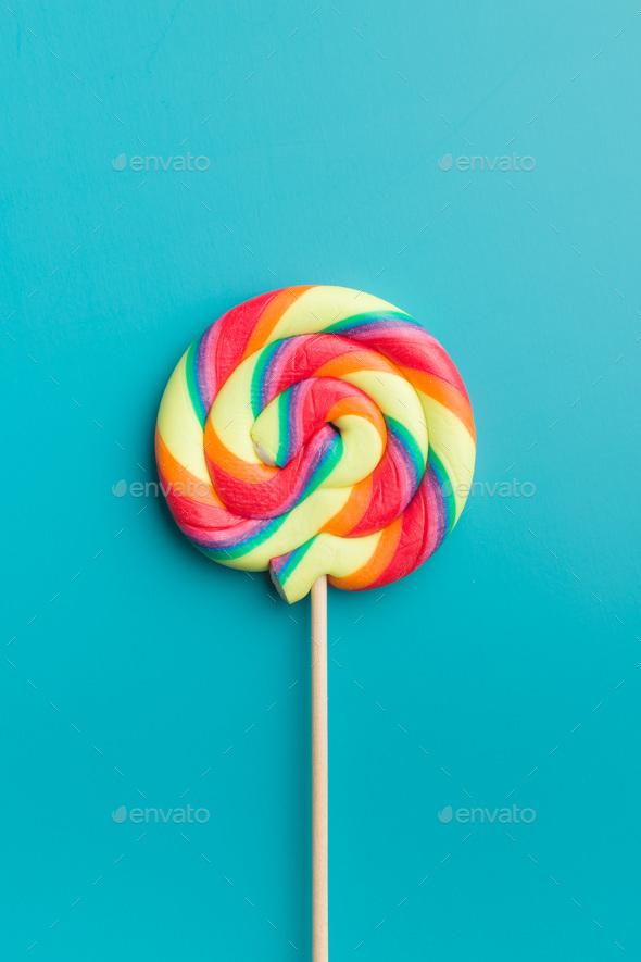 Colorful rainbow swirl lollipop. - Stock Photo - Images