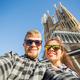 Couple taking selfie photo in front of the Sagrada Familia in Barcelona - PhotoDune Item for Sale
