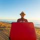 Man in glasses and hat carring his red suitcase near the sea - PhotoDune Item for Sale