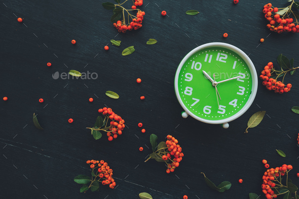 Plastic green clock on dark background, flat lay - Stock Photo - Images
