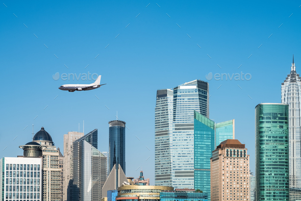 modern buildings and airplane - Stock Photo - Images