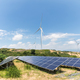 renewable energy landscape,wind farm and photovoltaic power station on sandy land - PhotoDune Item for Sale