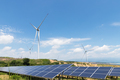 renewable energy landscape, solar panels and wind turbines with blue sky - PhotoDune Item for Sale