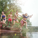 Enjoying river party with friends. Group of beautiful happy young people at the river together - PhotoDune Item for Sale