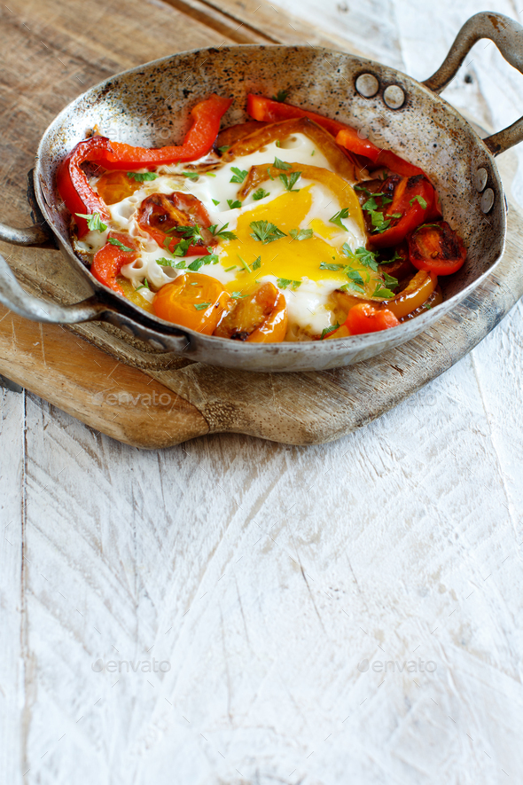 Fried egg with a bell pepper and tomatoes - Stock Photo - Images