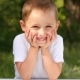 A Charming Little Boy Looks at the Camera and Smiles - VideoHive Item for Sale