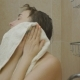 Attractive Caucasian Woman Wipes Her Face with a Towel Closing Eyes - VideoHive Item for Sale