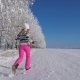 Woman Running Away Into The Distance On A Snow Covered Field On Winter Fairy Day - VideoHive Item for Sale