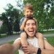 Happy Father Carrying His Smiling Son on Neck and Making Video Selfie - VideoHive Item for Sale