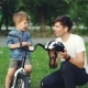 Caring Father Is Holding Bicycle Helmet and Talking To His Adorable Son Explaining Safety - VideoHive Item for Sale