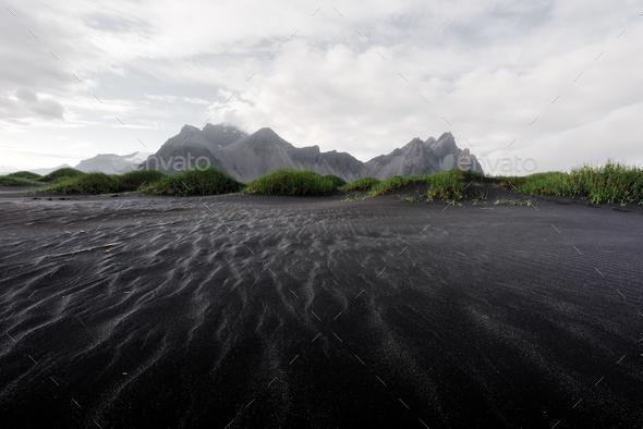 Famous Stokksnes mountains on Vestrahorn cape - Stock Photo - Images