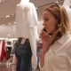 Girl Talking on the Phone in a Clothing Store - VideoHive Item for Sale