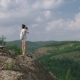 Woman Photographer Takes a Picture of a Mountain Landscape on the Camera - VideoHive Item for Sale