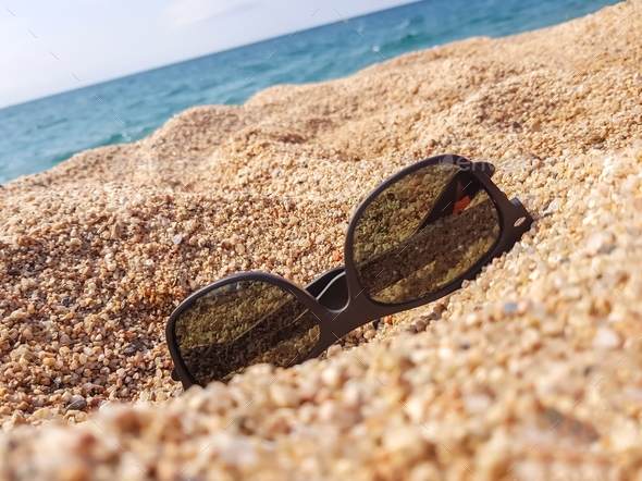 Sunglasses on the sand beach - Stock Photo - Images