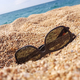 Sunglasses on the sand beach - PhotoDune Item for Sale