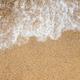 Ocean wave on sandy beach - PhotoDune Item for Sale