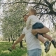 Father and Son Playing at Park. Father Raises Child in Arms. Fatherhood Concept - VideoHive Item for Sale