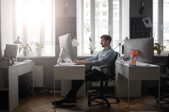 A man working in a modern design office - Stock Photo - Images