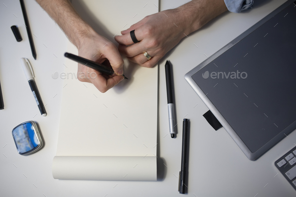 Designer hands drawing design project. - Stock Photo - Images