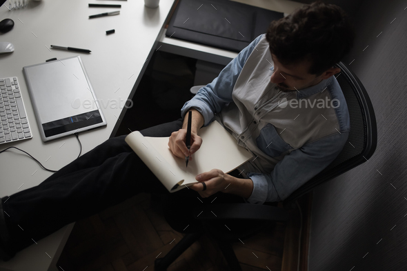 Designer drawing design project. - Stock Photo - Images