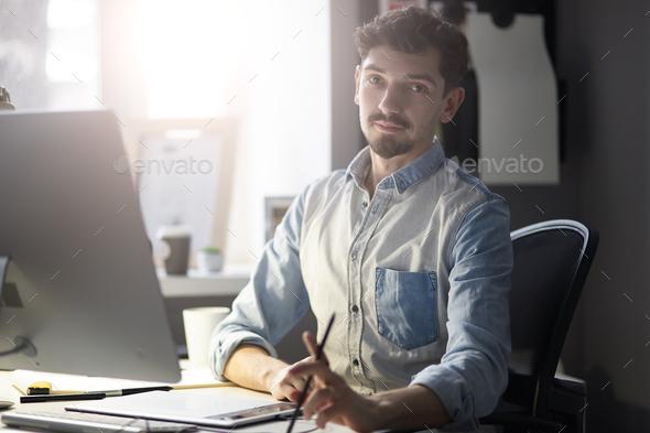 Portrait of young confident entrepreneur - Stock Photo - Images