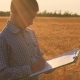 Boy Agronomist Makes Notes in Documents About State of Crops of Grain - VideoHive Item for Sale