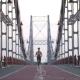 Fitness Female Jogging at Sunrise on Bridge - VideoHive Item for Sale