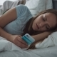 Tired Woman with Sad Eyes Using Smartphone on Bed at Home - VideoHive Item for Sale