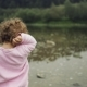 Blonde Curly Little Girl Throw Stones in the River - VideoHive Item for Sale