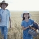 Young Farmers Are Walking Along the Wheat Field with Bread Baskets - VideoHive Item for Sale