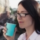 Successful Businesswoman Looking Into Distance, Drinking Coffee and Enjoying - VideoHive Item for Sale