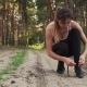 Athletic Woman Ties Her Shoelaces and Starts Running - VideoHive Item for Sale