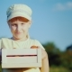 Portrait of a Child Farmer. The Girl Is Standing on the Field, Holding a Small Box with Tomatoes - VideoHive Item for Sale