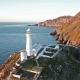 Aerial View of South Stack with Lighthouse and Cliffs During Sunset - VideoHive Item for Sale