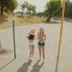 Hipster Girls in Sunglasses Having Fun Making Bubbles Outdoors - VideoHive Item for Sale