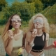 Pretty Hipster Girls in Sunglasses Having Fun Making Bubbles Outdoors - VideoHive Item for Sale