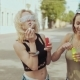 Cheerful Hipster Girls with Sunglasses Having Fun Making Bubbles at Street - VideoHive Item for Sale