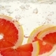 Round Grapefruit Slices Slowly Sink in Water - VideoHive Item for Sale