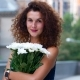 Portrait Attractive Curly Girl with White Flowers - VideoHive Item for Sale